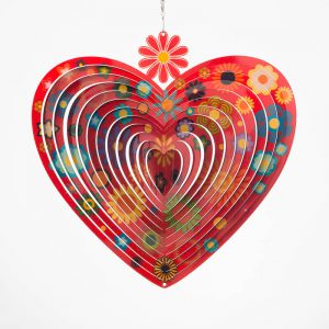 Flowers on red heart shaped wind spinner
